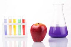 Fruit close chemical test tubes. Genetic Royalty Free Stock Photography