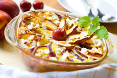 Fruit cobbler. Cobbler in a casserole with nectarines and cherries royalty free stock photography