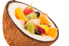 Fruit cocktail. Tropical fruits and berries placed in the coconut Royalty Free Stock Photos