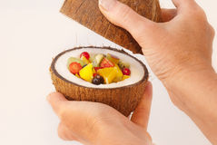 Fruit cocktail. Tropical fruits and berries placed in the coconut Stock Photography