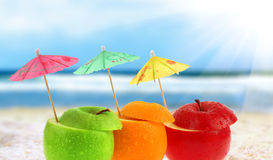 Fruit cocktail. On the beach, blurred background Royalty Free Stock Image