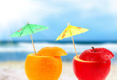 Fruit cocktail on a beach. Fruit cocktail on the beach, blurred background Stock Photos