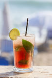 Fruit cocktail on a beach Stock Images