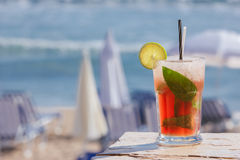 Fruit cocktail on a beach Stock Photos
