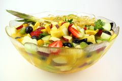 Fruit Cocktail. A Bowl of Fruit Cocktail containing pineapple, strawberry , apple, kiwi fruits, oranges, grapes with orang juice Royalty Free Stock Photos