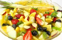 Fruit Cocktail. A Bowl of Fruit Cocktail containing pineapple, strawberry , apple, kiwi fruits, oranges, grapes with orang juice Royalty Free Stock Photography
