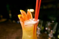 fruit cocktail in a glass with orange slices and tubules royalty free stock image