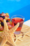 Fruit cocktail with grapes, blackberries and starfish. Stock Images