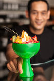 Fruit cocktail served in presentable glass bowl Stock Photos