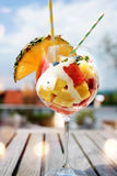 Fruit cocktail on a summer terrace. Exotic fruit cocktail served on a terrace in summer stock photo