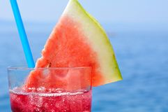 Fruit cocktail with water melon slice on a beach Stock Image
