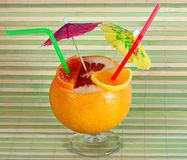 Fruit cocktails. Drink on bamboo background Royalty Free Stock Photos
