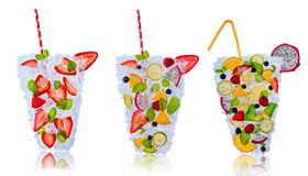 Fruit cocktails with ice cubes on white background Royalty Free Stock Image