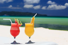 Fruit cocktails on tropical beach Royalty Free Stock Photo