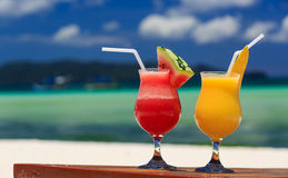 Fruit cocktails on tropical beach Stock Photos