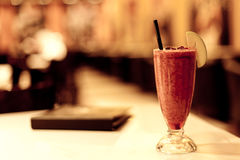 Fruit coctail and menu in cafe Royalty Free Stock Photos