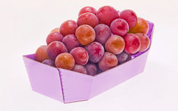 Fruit in colorful bowl. Frozen grapes in a pink paper box on white background Royalty Free Stock Photo