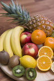 Fruit composition. Some juicy fruit arranged on a wooden board, vivid colours Royalty Free Stock Photo