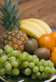 Fruit composition. Some juicy fruit arranged in a metal bowl, vivid colours Royalty Free Stock Photography