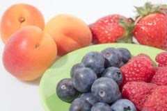Fruit composition, blueberries, raspberries, cherries, strawberr. Ies and apricot composition Royalty Free Stock Photography
