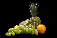 Fruit composition. Fruits on black background isolated in studio Royalty Free Stock Image