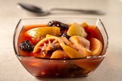 Fruit Compote in Clear Bowl and Clean Bakcground royalty free stock image