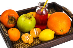 Fruit, cookies, nuts, wooden tray, white background Royalty Free Stock Photography