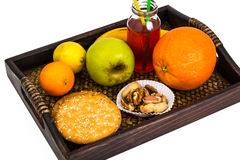 Fruit, cookies, nuts, wooden tray, white background Stock Image