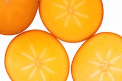 Fruit coupé en tranches de kaki Photo libre de droits