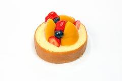 Fruit cream roll cake. Slice pastry mango strawberry blackberry Royalty Free Stock Image