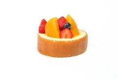 Fruit cream roll cake. Slice pastry mango strawberry blackberry Royalty Free Stock Photography