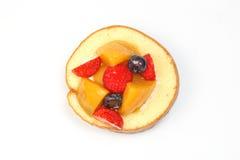 Fruit cream roll cake. Slice pastry mango strawberry blackberry Stock Photos