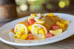 Fruit Crepes. A dish of crepes filled with fresh tropical fruits Royalty Free Stock Image