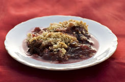 Fruit crumble. Dessert with plums and berries stock photos