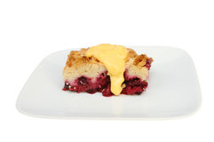 Fruit crumble and custard Royalty Free Stock Photography