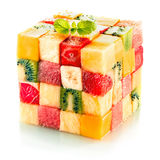 Fruit cube with assorted tropical fruit. Fruit cube formed from small squares of assorted tropical fruit in a colorful arrangement including kiwifruit Stock Image