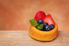 Fruit Cupcake. Sponge cake with fresh blueberry and strawberry Stock Image