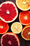 Fruit in a cut closeup, grapefruit, orange, lemon, tangerine, fruit background. rustic food. fruit. Fresh fruits.Mixed fruits back Stock Photos