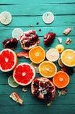Fruit in a cut closeup, grapefruit, orange, lemon, tangerine, fruit background. rustic food. fruit. Fresh fruits.Mixed fruits back Royalty Free Stock Photo