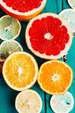 Fruit in a cut closeup, grapefruit, orange, lemon, tangerine, fruit background. rustic food. fruit. Fresh fruits.Mixed fruits back Stock Images