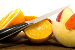 Fruit cutted with knife Royalty Free Stock Image