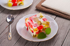 Fruit dairy, red and green jelly on a plate. Royalty Free Stock Photography
