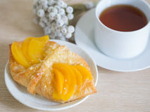 Fruit danishs on wooden table. Fruit, peach danish on wooden table Royalty Free Stock Photos
