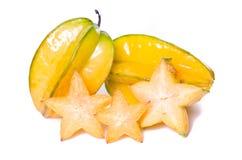 Fruit de caïmite avec à moitié la section transversale d'isolement sur le blanc Images libres de droits