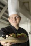Fruit de fixation de chef Images stock