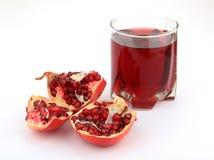 Fruit de grenade avec du jus Photographie stock