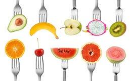 Fruit de mélange pour le régime avec la fourchette photographie stock