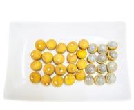 Fruit de plot réflectorisé dans un plat V Images stock