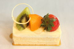 Fruit  decorated pastries  cakes and slices of cakes. Royalty Free Stock Photo