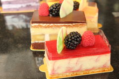 Fruit  decorated pastries  cakes and slices of cakes. Royalty Free Stock Photos